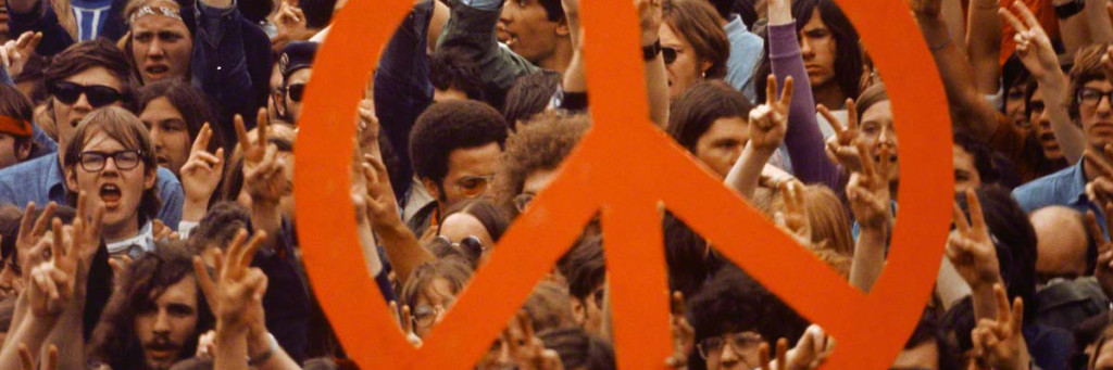 ca. 1970, Washington, DC, USA --- A large peace sign is held up by activists during a Vietnam War demonstration on Capitol Hill. --- Image by © Wally McNamee/CORBIS