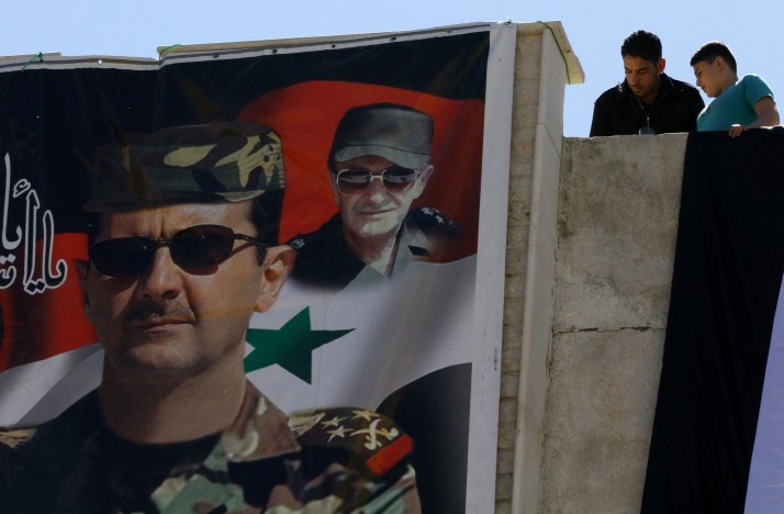 Une affiche représentant Bashar Al-Assad. Photo Louai Beshara/AFP/Getty Images)