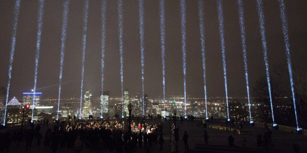 Fourteen beams of light shine toward the sky during a ceremony marking the 28th anniversary of the Montreal Massacre when a gunman shot 14 women to death and injured 14 other people, in Montreal on Wednesday, December 6, 2017. THE CANADIAN PRESS/Ryan Remiorz