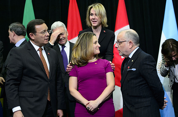United States Ambassador to Canada Kelly Craft places her hands on the shoulders of Minister of Foreign Affairs Chrystia Freeland during a family photo at the 10th ministerial meeting of the Lima Group in Ottawa on Monday, Feb. 4, 2019. THE CANADIAN PRESS/Sean Kilpatrick