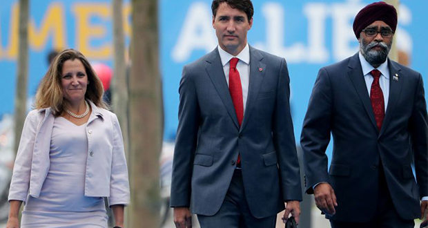 (L-R) Canada's Foreign Minister Chrystia Freeland, Canadian Prime Minister Justin Trudeau and Canadian Defence Minister Harjit Sajjan arrive to attend the North Atlantic Treaty Organization (NATO) summit in Brussels on July 12, 2018. (Photo by Tatyana ZENKOVICH / POOL / AFP)        (Photo credit should read TATYANA ZENKOVICH/AFP/Getty Images)