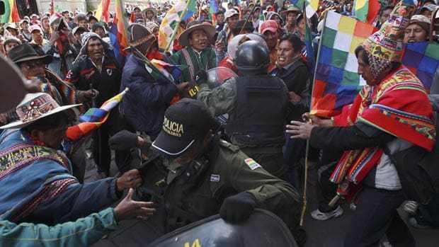 Bolivian-minters-battle-police