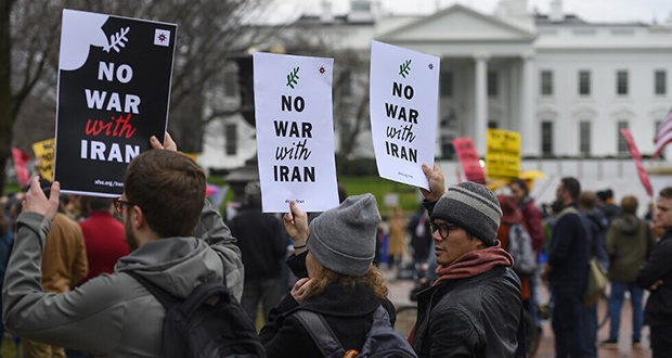 Anti-war activist protest in front of the White House in Washington, DC, on January 4, 2020. - Demonstrators are protesting the US drone attack which killed Iran's Major General Qasem Soleimani in Iraq on January 3, a dramatic escalation in spiralling tensions between Iran and the US, which pledged to send thousands more troops to the region. (Photo by ANDREW CABALLERO-REYNOLDS / AFP)